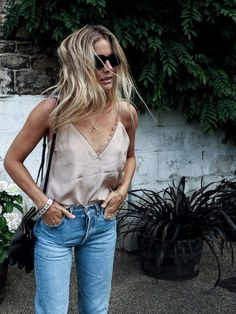 Everything from show-some-skin camis to lofty heels has been given the satin treatment this season, and while the trend might not be the most practical, it's certainly luxe. For a feminine take choose barely-there slip dresses and girlish pleats, or toughen up the look by layering a cami top over a basic white tee or tucking it into your Levi's 501s like Lucy Williams. Whichever way you choose to wear the look, this is the trend that'll make you feel modern and sexy in equal measure.