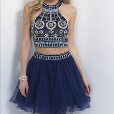 A blue two piece home coming dress. Cocktail style I ordered it for my junior homecoming and it didn't come in on time so I never got to wear it. Brand new, never been worn. Size 2 with no alterations Dresses Mini