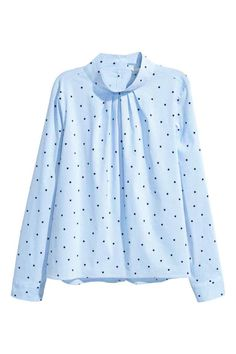 Blouse with a stand-up collar: Patterned blouse in an airy cotton blend with a stand-up collar, gathers at the neck and long sleeves with buttoned cuffs. The blouse is gently flared with buttons down the back.