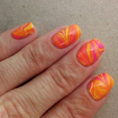 """My first attempt at """"dry"""" watermarble! Used China Glaze Glow With The Flow and Sun-Kissed, marbled them and let the sheet dry on the water, then cut it into smaller pieces and applied them over half-dry white polish."""
