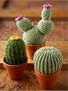Knitted Cactus pincushions. Idea - reuse old sweaters instead! :)