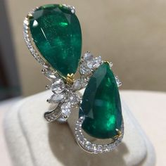 Pear shape emeralds with diamonds ring。 I Love Jewelry, High Jewelry, Jewelry Stores, Emerald Jewelry, Diamond Jewelry, Diamond Earrings, Pear Ring, Diamond Heart, Diamond Are A Girls Best Friend