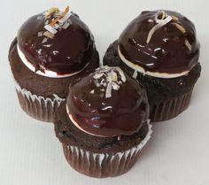 """One of the best combinations is Marshmallow and Chocolate and we're bringing it to you in our newest cupcake, the Mallo Cup""""cake"""".  It's a Dark Chocolate cake filled with a Marshmallow Creme and Toasted Coconut. Topped with the same and covered with a Chocolate ganache and Toasted Coconut sprinkles. Just like the candy bar! #cupcakes #cupcakedesign #cupcakedecorating #mallocup #chocolate #marshmallow"""