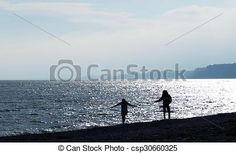 Girlfriends silhouetted on the beach.