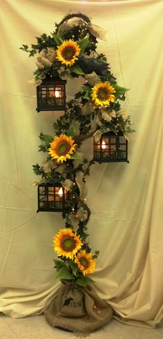 18 cheerful sunflower wedding centerpiece ideas page 2 of 2 burlap and sunflower wedding ideas gorgeous 3 tier lantern with burlap sunflowers and crows junglespirit Image collections