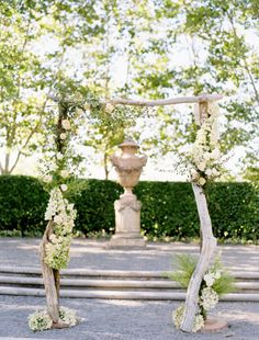 dried logs wedding altar with white flowers