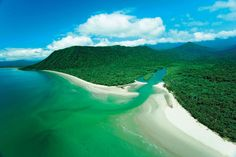 Cape Tribulation, Australia... (3.5 hr drive from Cairns Australia along 2 lane road).  At one point you have to take a ferry to cross a crocodile invested lake!