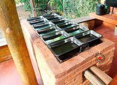 Resultado de imagem para restaurantes com fogão de lenha Stove, Kitchen Appliances, Outside Wood Stove, Restaurants, Diy Kitchen Appliances, Home Appliances, Range, Domestic Appliances, Stoves