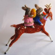 Needle felted rabbits riding a deer...awesome.