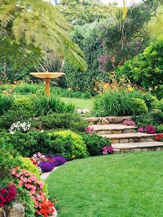 daylily border around top level; mixed low shrubs and annuals on lower.  Great steps, birdbath focal point.