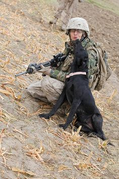 U.S. Marine Corps Cpl. JT Eckert gets a kiss from his Improvised Explosive Device Detector Dog, Bee, during a security patrol in Kajaki, Afghanistan, on Oct. 29, 2010