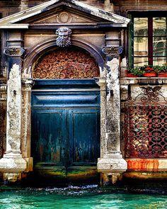 Venetian home with a rustic indigo blue door along Grand Canal, Venice, Italy