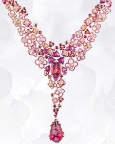 Necklace in pink gold, rubies, pink sapphires, rhodolite garnets, red and pink tourmalines, set with a drop of red tourmaline