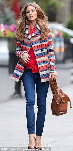 Pretty as a picture: Olivia wore tight blue jeans and a red shirt underneath the hip-length wool coat