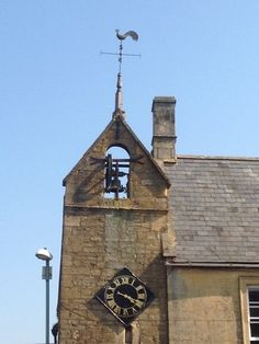 Cotswolds. Bell and clock at Moreton in the Marsh
