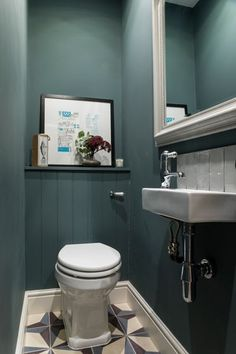 Design & styling by Imperfect Interiors at this lovely house in Tongue & Groove panelling, Fired Earth tiles & Farrow & Ball Inchyra Blue in the downstairs loo.uk Photos by Chris Snook Space Saving Toilet, Small Toilet Room, Guest Toilet, Home Interior, Bathroom Interior, Interior Design, Office Bathroom, Interior Styling, Cloakroom Toilet Downstairs Loo