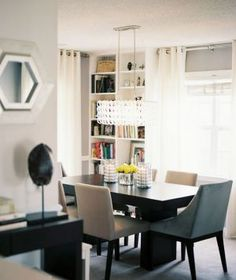 Dining room interior design - http://myLusciousLife.com - Books in the dining room via Lonny Mag.jpg