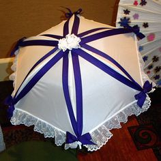 Ooh! I already have a white parasol like this! Adding ribbon would be soooo easy!