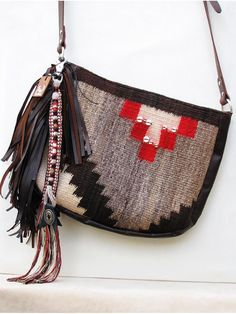 tasseled cross body pouch