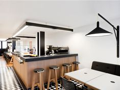 Black and white reigns in this modern new Parisian coffee shop. Pool is the visionary design team giving this hang out a true design identity. Hints of color like, bright pencils on the table, brea...