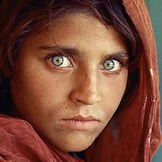 Afghan Girl haunting eyes that adorned the front on the National Geographic Magazine - I remember staring at this photo when we got the magazine.  This link also shows the same girl in 2002.