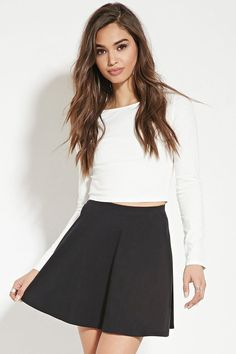 A knit mini skirt with a skater silhouette and an elasticized waist.
