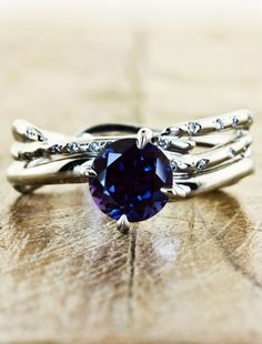 Such beautiful nature-inspired engagement rings :)...not sure about the blue but live the actual ring!