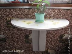Складной столик для маленького балкона.