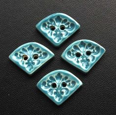 Set of four small turquoise ceramic buttons