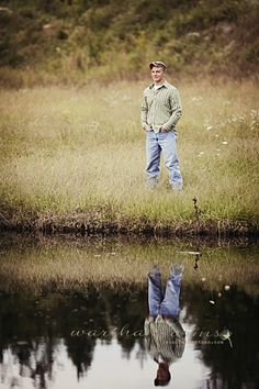 I am loving this reflection in the water pose. This would be great for Ammon's Senior pics. Male Senior Pictures, Senior Photos, Senior Guys, Senior Year, Boy Senior Pics, Senior Boy Photography, Photography Poses, Senior Portrait Poses, Senior Session