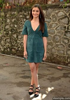 Alia Bhatt in a Zara dress with a plunging neckline, paired with strappy black Zara heels and Dior earrings. via Voompla.com