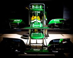 Front wings are stacked in front of the Caterham Team garage at the US Grand Prix in Austin, Texas. Gaming Pcs, Dell Computers, Computer Technology, Austin Texas, Grand Prix, F1, Monitor, November, Garage