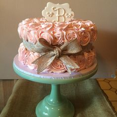 Pink rosettes + lace/burlap ribbon = the sweetest baby shower cake for @werndle_gmeiner celebrating the arrival of her daughter Brooke!