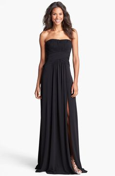 Elegant meets trendy: pleated bodice and leg-slit on a full length gown
