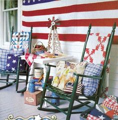 Great porch decor. Like the idea of blanket on the back on the chair for when it's chilly outside. For a party maybe?