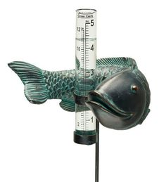 """Garden Rain Gauge with Fish and Glass Tube by Plow & Hearth. $12.95. Decorative garden rain gauge. Includes glass tube for easy measuring of rainfall. 5-1/4""""L x 4-1/2""""W x 11""""H. Features metal and resin fish with verdigris finish. This fish garden rain gauge brings smiles even on rainy days. A perfect and practical garden friend, our fish swims around his gauge and is crafted of metal and resin. Fish rain gauge includes a glass measuring tube."""