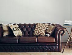 #chesterfield #design #scandinavian #chic #wood #danish #lamp #cow leather #cow #table #grey #brick #sofa