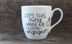 A perfect mug for the newly engaged gal!  This listing is for one white, high-quality ceramic coffee mug with the words Does this ring make