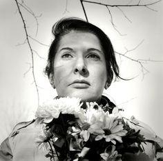 Marina Abramovic with flowers. http://www.dazeddigital.com/artsandculture/article/16842/1/the-da-zed-guide-to-marina-abramovic