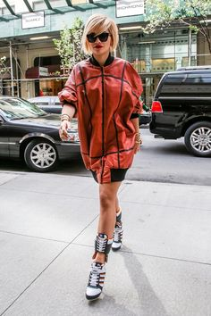 Pin for Later: What's All the Fuss About? Rita Ora's Always Dressed Sexy Rita Ora Arriving to a New York Office Her leather jacket seemed to be missing the accompanying pants. That was no problem for Rita, who bared her gams with corset-like lacing.