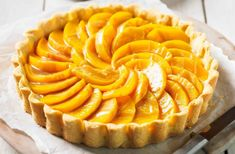 A sweet, fruity twist on a classic, this glorious tart is filled with luxe crème pâtissière and is the ultimate summer show-stopper. Healthy Fruit Desserts, Köstliche Desserts, Delicious Desserts, Dessert Recipes, Caramel Treats, Caramel Tart, Baked Peach, Tart Filling, Tesco Real Food