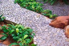 Garden paths and walkways are important elements of yard landscaping and backyard designs