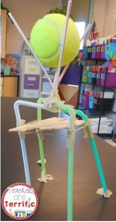 """Given 8 straws, 8 craft sticks, 2 rubber bands, 6"""" masking tape, build a tower that would support a tennis ball. The ball had to be 10 cm off the table. You MUST use ALL the supplies!"""