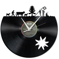 This Swiss wall clock is made from old vinyl records. With over a dozen different scenes to choose from, this upcycled clock will definitely refresh your living room. Old Vinyl Records, Record Clock, Record Collection, The Conjuring, Decoration, Switzerland, Clocks, Cnc, Illustration