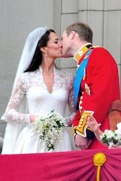 Newly weds Prince William and Catherine Middleton share their first public kiss on the balcony at Buckingham Palace, April 29, 2011. Kate & William married at Westminster Abbey and will now be known as the Duke & Duchess of Cambridge.