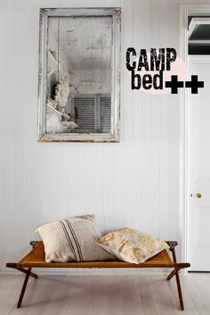 camp bed.    MUST get our old canvas and metal ones from my parents house before summer visitors arrive!