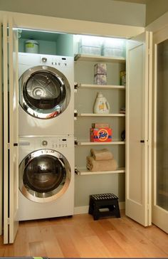 Stacked washer/dryer  storage behind doors. I love the idea of not having a laundry room, but more of a laundry closet.