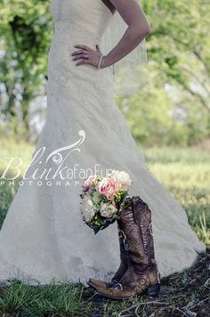Picture of boots and bouquet with the dress in the background . . . Love everything about this picture!