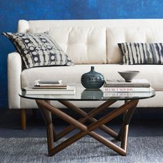 Spindle Coffee Table | West Elm I like this because it's small and has a glass top which helps in a small room.  I'll give you a trunk option as well.