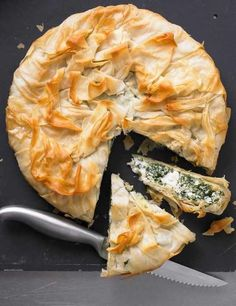This spinach and ricotta vegetarian pie made with filo pastry is very light at under 200 calories per slice. Ready in under an hour you can make it ahead and cook it when you need it.